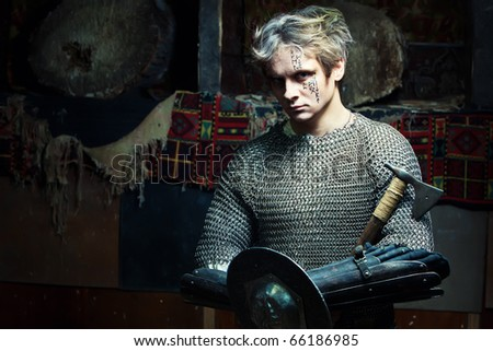 Medieval warrior in the chain armour with the axe and shield. - stock photo