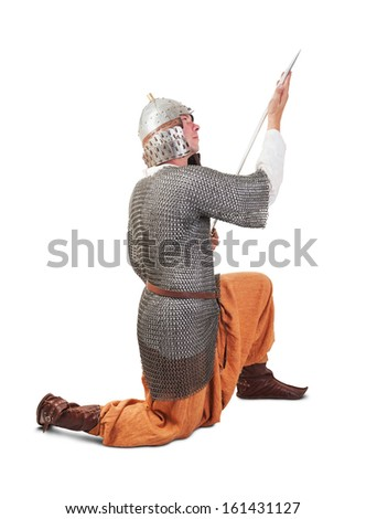 medieval warrior man wearing in ancient armor with sword - stock photo