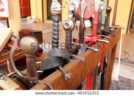 medieval weapons swords and shields - stock photo