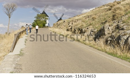 Medieval windmill on a hill overlooking the town of Consuegra in Toledo province, Spain. They dating from the 16th century. - stock photo