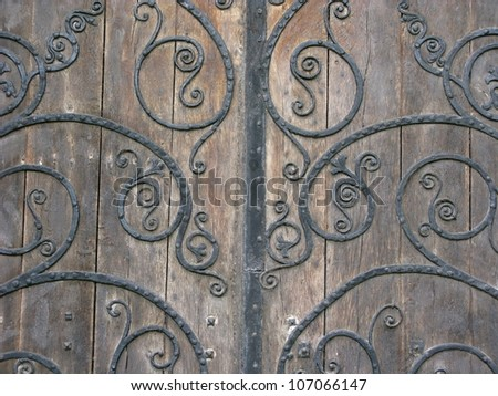 Medieval wrought iron and wood door - stock photo