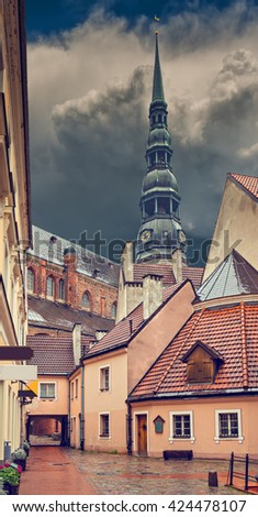 Medieval yard in old Riga city. Riga is the capital and largest city of Latvia, a major commercial, cultural, historical, tourist and financial center of the Baltic region - stock photo