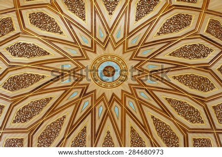 MEDINA, SAUDI ARABIA-CIRCA MAY 2015: Close up view of the dome inside of Nabawi Mosque on MAY, 2015 in Medina, Saudi Arabia. The Mosque is the 2nd holiest mosque in Islam. - stock photo