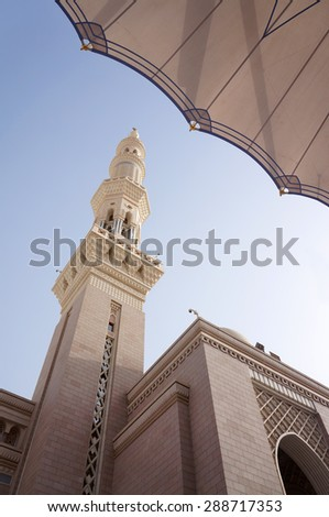 MEDINA, SAUDI ARABIA-CIRCA MAY 2015: Minaret of Nabawi Mosque from lower angle in the evening on MAY, 2015 in Medina, Saudi Arabia .This mosque is the second holiest mosque in Islam. - stock photo