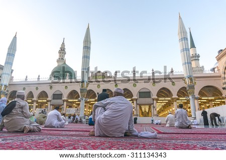 MEDINA, SAUDI ARABIA - MARCH 09, 2015 : Pilgrims resting after fajr pray inside Nabawi Mosque. Nabawi Mosque is the second holiest mosque in Islam and here is Prophet Muhammad is laid to rest  - stock photo