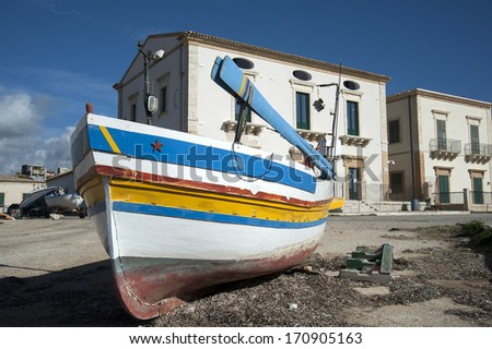 meditarranean harbour landscape with fisherboat, donnalucata, sicily, italy  - stock photo