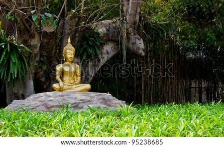Meditation Buddha statue. Under the Bodhi tree - stock photo