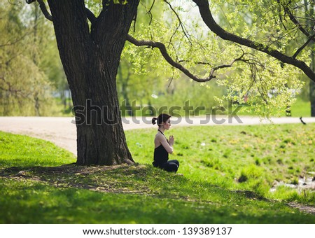 Meditation in nature - stock photo