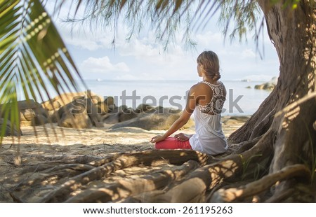 Meditation. photo of a woman who is sitting in the lotus position - stock photo