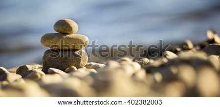 Meditation stones - relaxing on the beach - website banner - stock photo