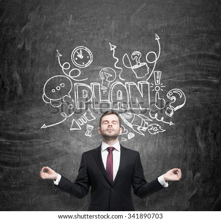 Meditative businessman is dreaming about building of a business plan for business development. Business plan sketch is drawn on the black chalkboard. - stock photo