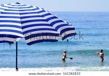 Mediterranean beach during hot summer day - stock photo