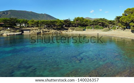 Mediterranean cove with clear water and pebble beach in Cadaques, Costa Brava, Catalonia, Spain - stock photo