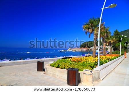 Mediterranean promenade filled with vegetation - stock photo