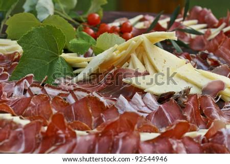 Mediterranean prosciutto and cheese - stock photo