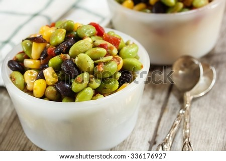 Mediterranean salad / Edamame salad, shallow depth of filed - stock photo