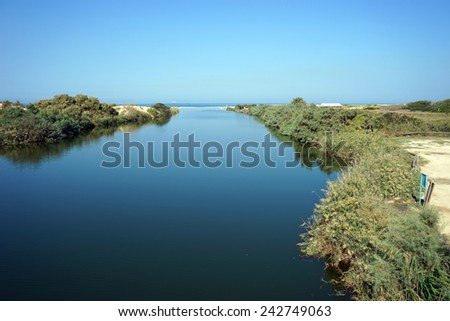 Mediterranean sea and mouth of river in Nahal Alexander national park in Israel                                - stock photo