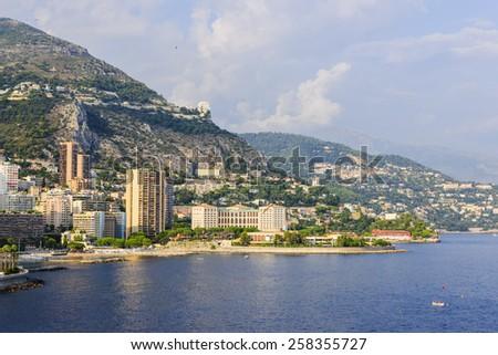 Mediterranean sea coast with view of Larvotto ward and beach in Monaco. - stock photo