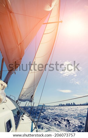 Mediterranean sea from beautiful sailboat, racing yacht in the Mediterranean sea on blue sky background - stock photo