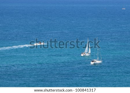 Mediterranean Sea Scene. Magnificent white yachts. - stock photo
