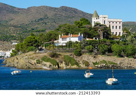 Mediterranean sea shore with boats on mooring buoys and waterfront house, village of Cadaques, Costa Brava, Catalonia, Spain - stock photo