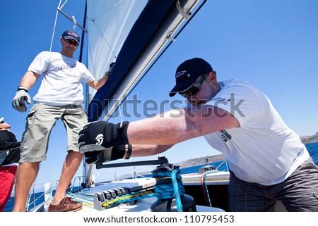 MEDITERRANEAN SEA, TURKEY- MAY 29: Unidentified sailor participates in sailing regatta Sail & Fun Trophy 2012 from Marmaris to Fethiye,  May 29, 2012 in the Mediterranean Sea, Turkey. - stock photo
