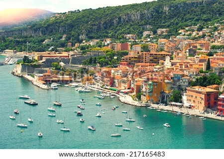 mediterranean sea. view of luxury resort and bay of Cote d'Azur. Villefranche, french riviera. sun beams. retro style toned picture - stock photo