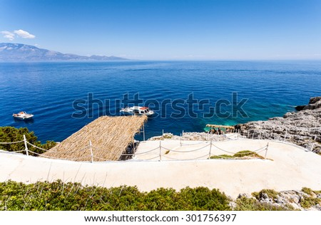 Mediterranean seascape with boat pier on the island - stock photo