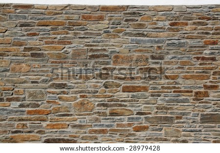 mediterranean stone wall, horizontal view of wide design - stock photo