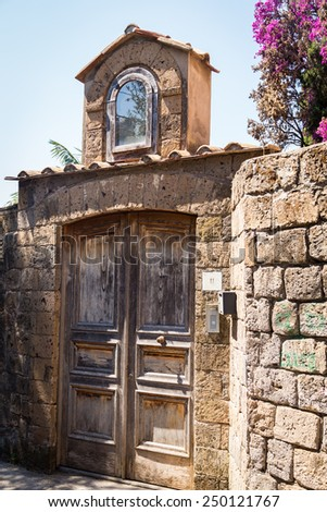 Mediterranean streets of the Italian city. The narrow, cobbled streets of the old town of the coastal southern Italy. architecture of old Italy. Hot day. City Tours Southern Italy. Travels in Europe. - stock photo