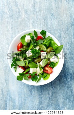 Mediterranean-style Salad with Green Olives  - stock photo