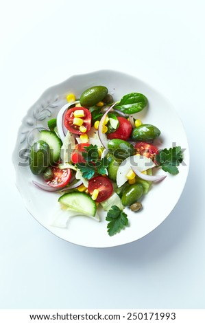 Mediterranean-style salad with whole green olives - stock photo