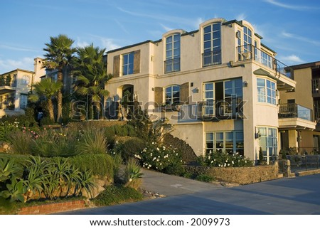 mediterranean style villa with blue sky and landscaping - stock photo