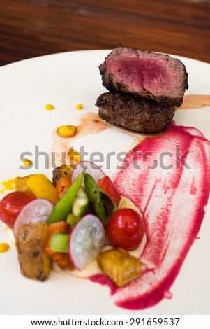 Medium Rare Beef Steak (selective focus on the meat) - stock photo