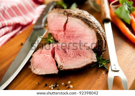 Medium Rare Cooked Beef Roast with Vegetables and Spices - stock photo