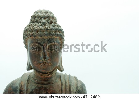 Medium shot of wooden buddha statue over white background - stock photo