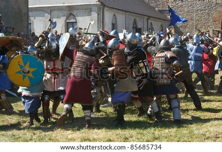 """MEDZHIBOZH, KHMELNITSKY REGION, UKRAINE - AUGUST 27: Unidentified men in knights costumes participate in the  Festival of medieval culture """"Ancient Medzhybizh"""". Knight's battle on August 27, 2011 in the Medzhibozh, Khmelnitsky region, Ukraine - stock photo"""