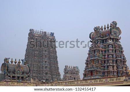 Meenakshi hindu temple in Madurai, Tamil Nadu, South India. Sculptures on Hindu temple gopura (tower). - stock photo