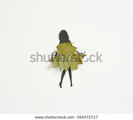 Meet Laurel ! A woman's  silhouette wearing a dress of laurel leaves on white background - stock photo