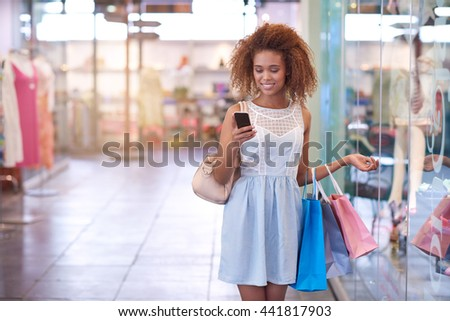 Meet me in front of our favorite clothing store - stock photo