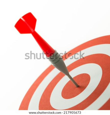 Meet target concept using dart pinned at the bullseye - stock photo