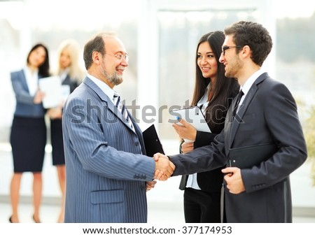meeting business partners in the office before presentation - stock photo