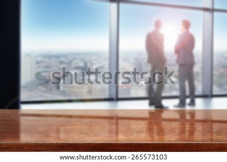meeting in office and dark brown desk space  - stock photo