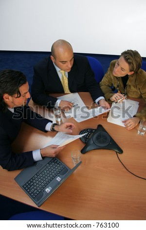 Meeting isolated with conference call phone - stock photo