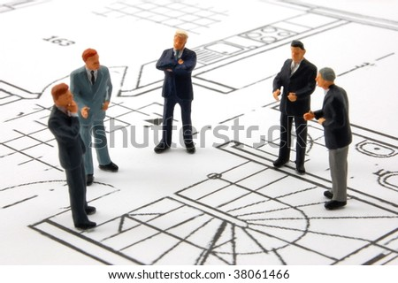 meeting of business man on architecture background - stock photo