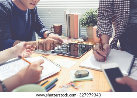 Meeting of designers discussing patterns for textile industry - stock photo