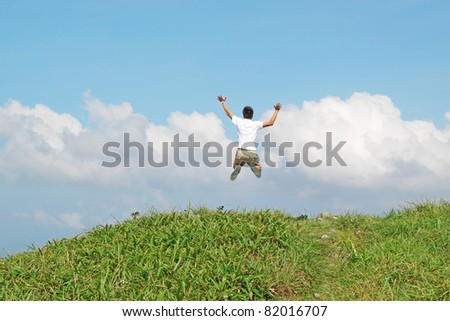 Meeting of the sky. The man on high mountain with the hands lifted above, on a background of blue sky - stock photo