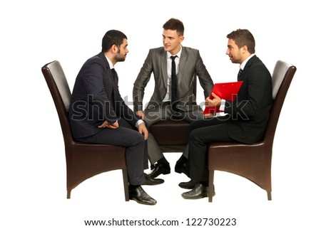 Meeting of three business men sitting on chairs and having conversation isolated on white background - stock photo