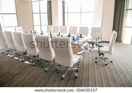 Meeting room with conference table - stock photo