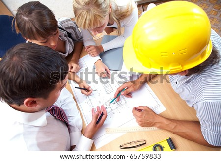 Meeting the team of engineers working on a construction project at the table. Up view - stock photo